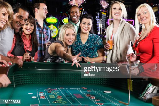 Diverse Group of People Playing Craps In Casino