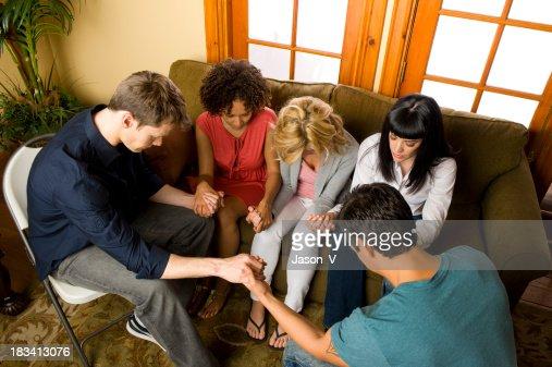Diverse group of people praying