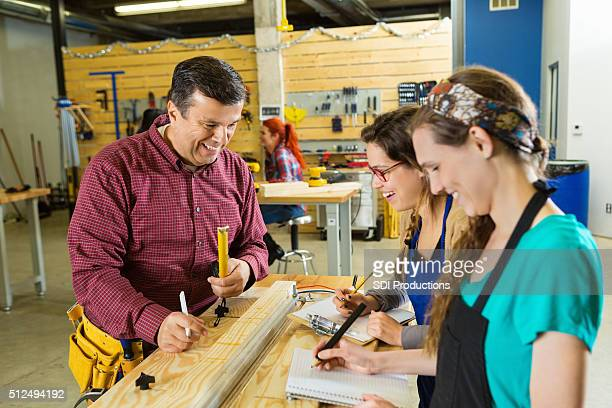 Diverse group of people work in workshop