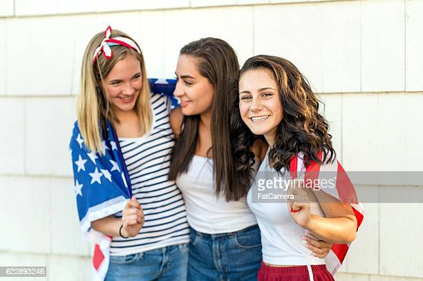 Diverse group of teenagers wearing an American flag