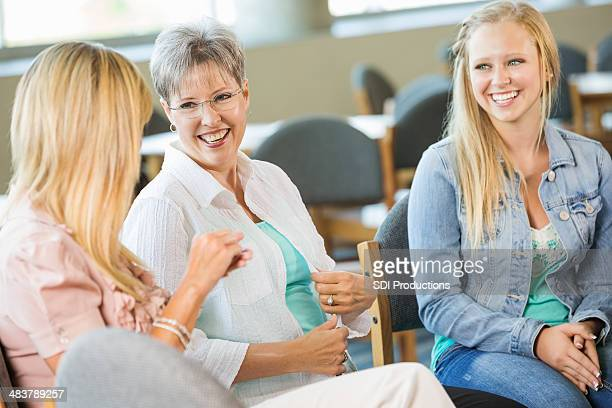 Diverse group of women discussing something together