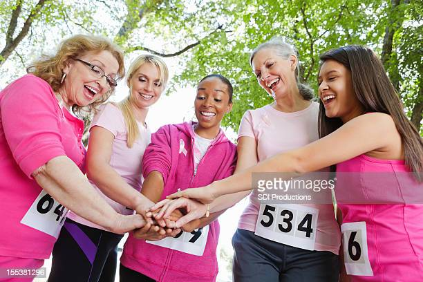 Diverse group of women showing teamwork during charity race