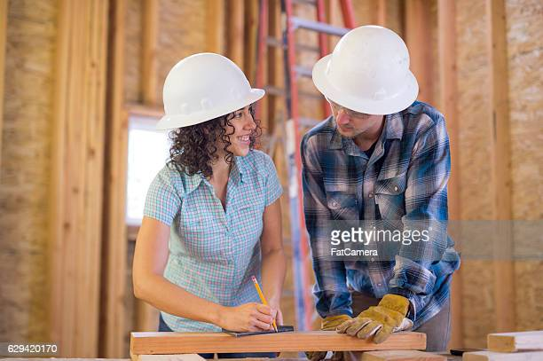 Diverse group of young adults working on DIY construction
