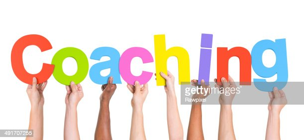 Diverse Hands Holding The Word Coaching : Stock Photo