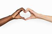 Diverse hands with love sign