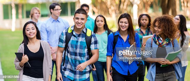 Diverse high school or college students walking on campus