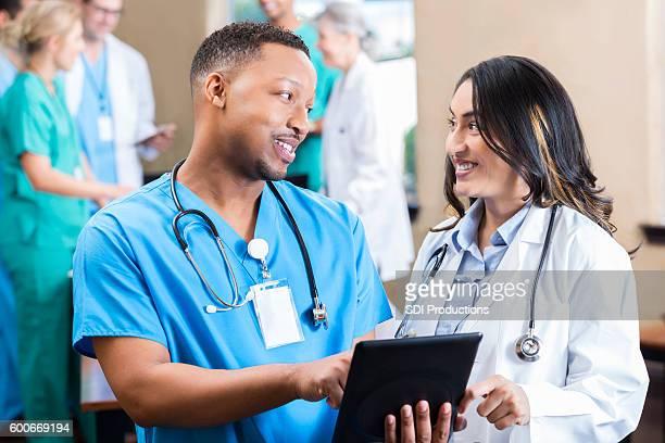 Diverse medical professionals talk about a diagnosis
