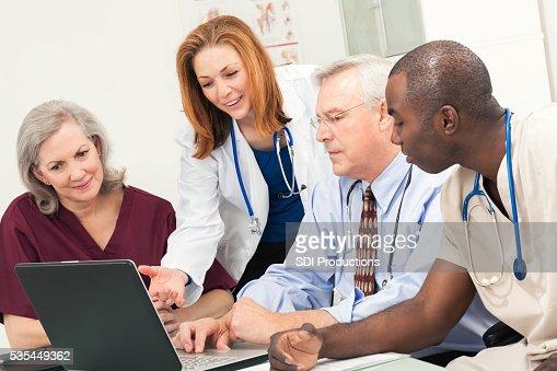Diverse medical team reviewing patient diagnosis