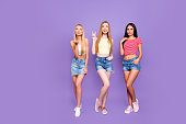 Diverse people concept. Full body concept of thin slender trio with long hair making different poses isolated on vivid violet background