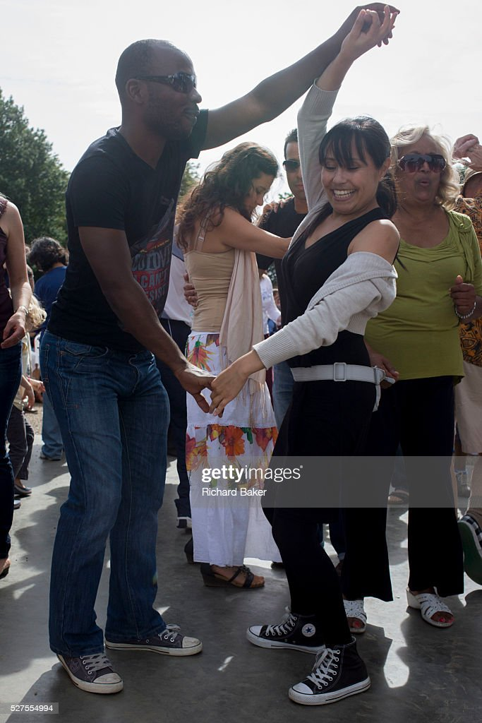 A diverse range of ages and ethnic backgrounds on the dancefloor as dancers enjoy an afternoon of a Latin music festival in south London The outdoors...