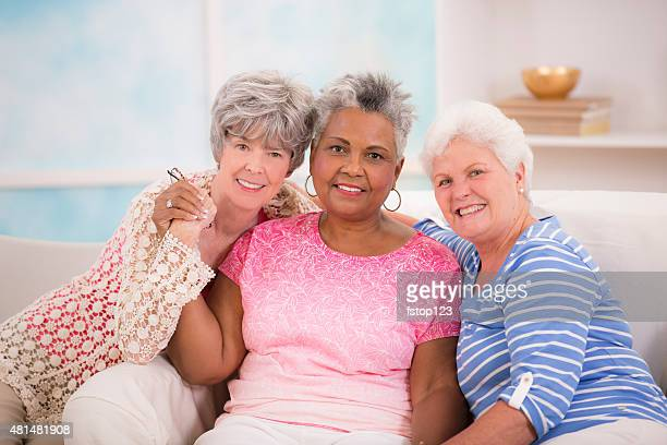 Diverse senior women friends share friendship. Assisted living or home.