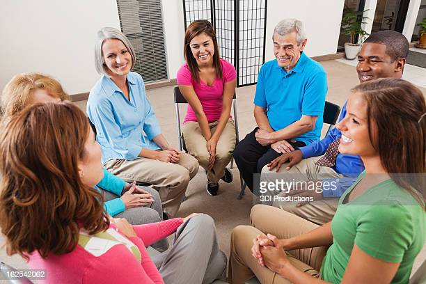 Diverse support group listening to friend tell story during discussion