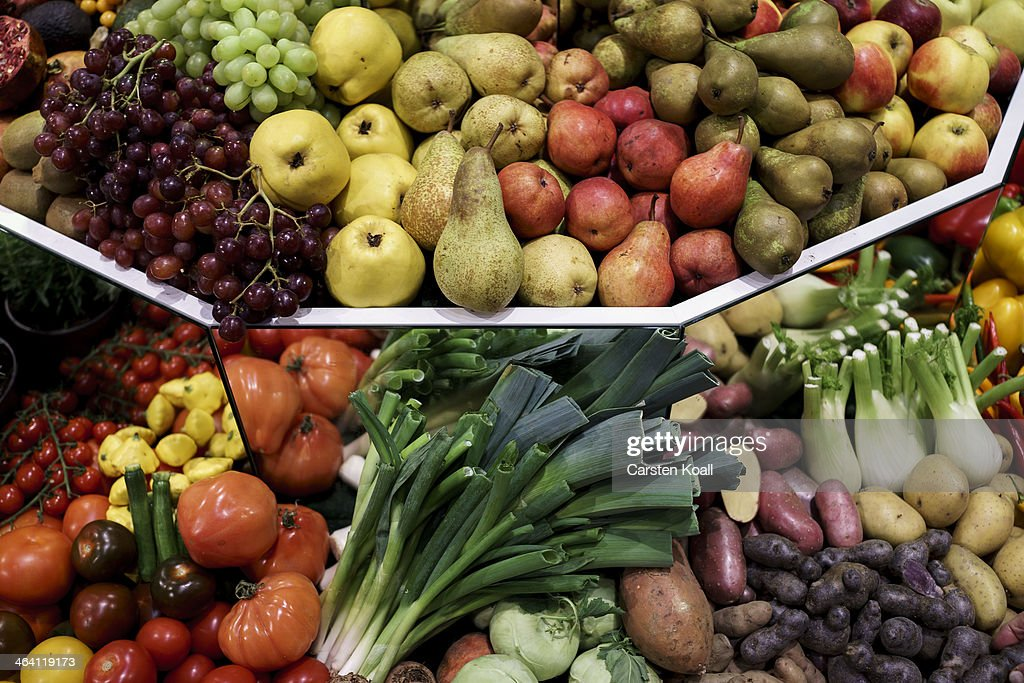 Diverse types fruits like Grapes, different sorts of apples, pears and diverse types of vegetables tomatoes, zucchini, kohlrabi, leeks, potatoes and fennel lying on a showcase at a stand at the Gruene Woche agricultural trade fair on January 20, 2014 in Berlin, Germany. The Gruene Woche is the world's largest agricultural trade fair and is open to the public until January 26.