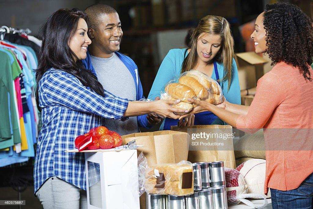 Diverse volunteers receiving donations at community food bank