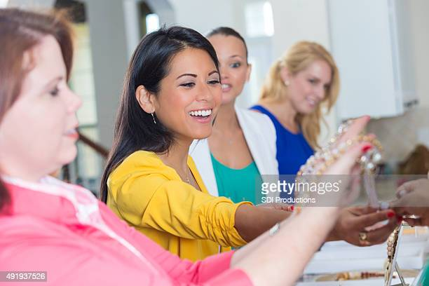 Diverse woman shopping during direct sales jewelry show