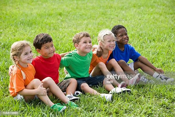 Diverse young children sitting together in a row