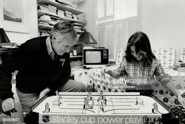 Diversionary tactics Broadcasteractor Don Harron plays table hockey with daughter Kelly 10 one of the ways he distracts her attention from TV in...