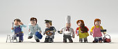 Diversity occupations people standing on arrows pointing to different direction and future.  Including doctor, cooker, driver, engineer, cleaner & veterinarian in colorful plastic block lifestyle.
