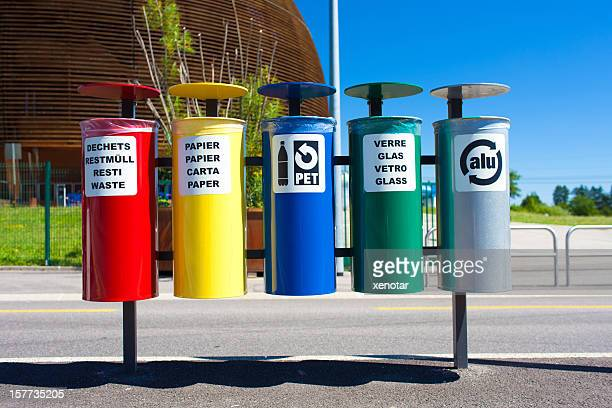 Divided recycling bins with different color and signs