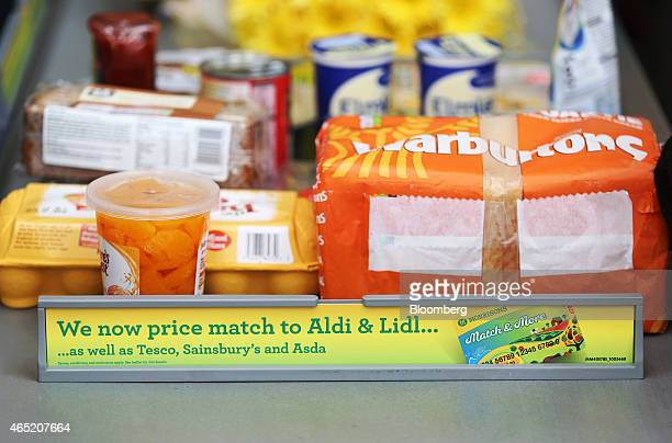 A divider advertising an in store price matching promotion against rival supermarkets of Aldi Lidl Tesco Sainsbury's and Asda sits on the checkout...