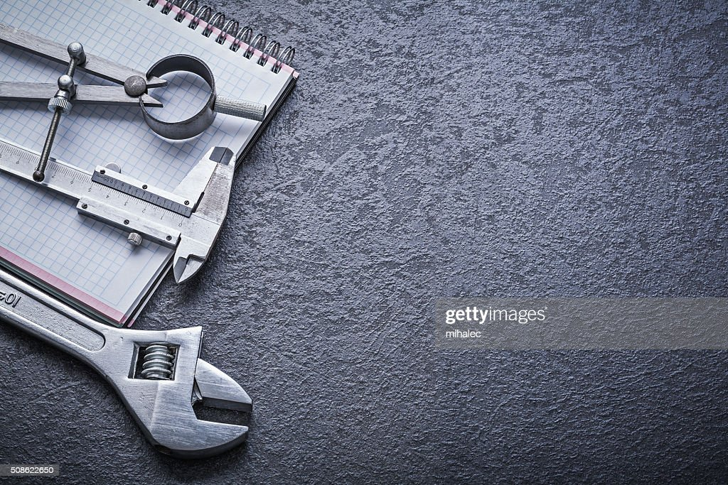 Divider calliper adjustable spanner notebook construction concep : Stock Photo