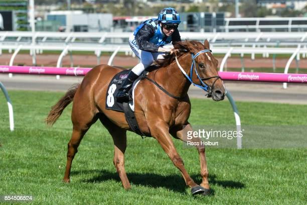 Divine Messenger ridden by Ethan Brown wins the Have You RSVP'd Handicap at Flemington Racecourse on September 27 2017 in Flemington Australia