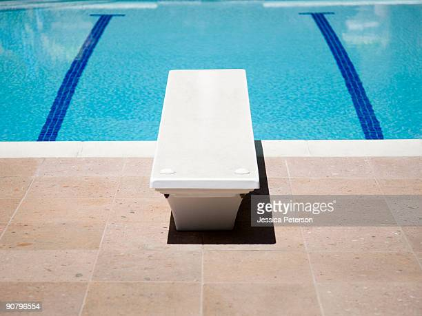 diving board and a swimming pool