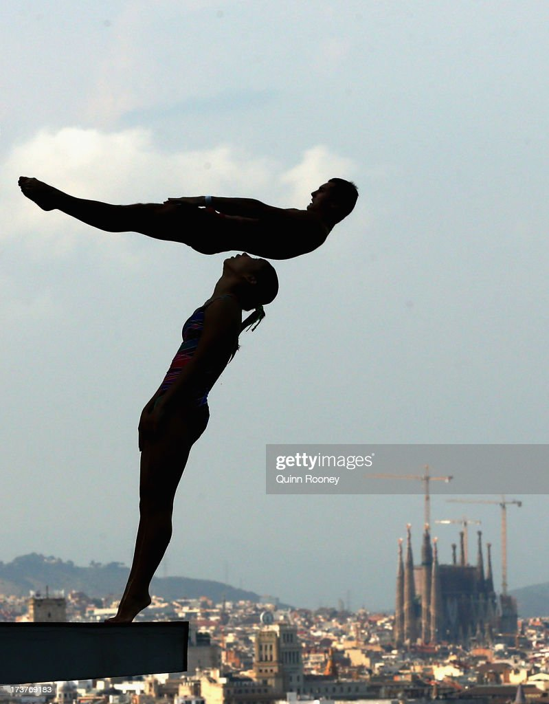 Diving competitors practice during a training session ahead of the FINA World Championships on July 18, 2013 in Barcelona, Spain.