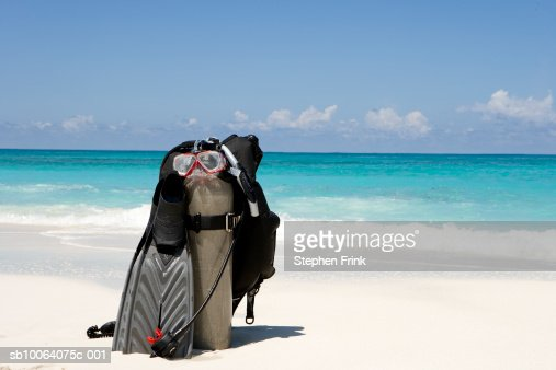 Diving equipment on tropical beach.
