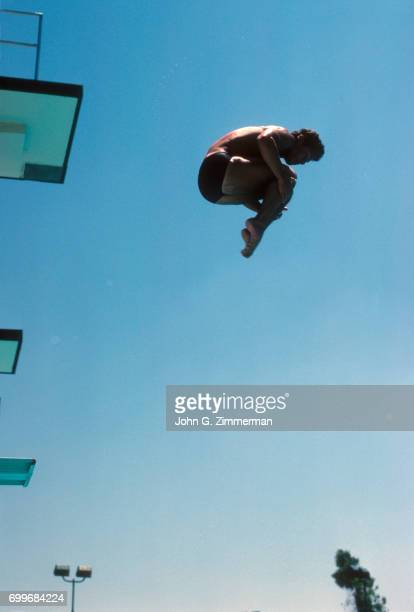 Greg Louganis in action from high dive at Mission Viejo International Swim Complex Mission Viejo CA CREDIT John G Zimmerman