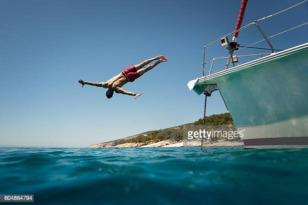Diving into the sea from yacht