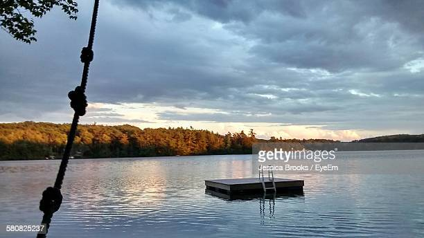 Diving Platform Amidst Lake Against Cloudy Sky