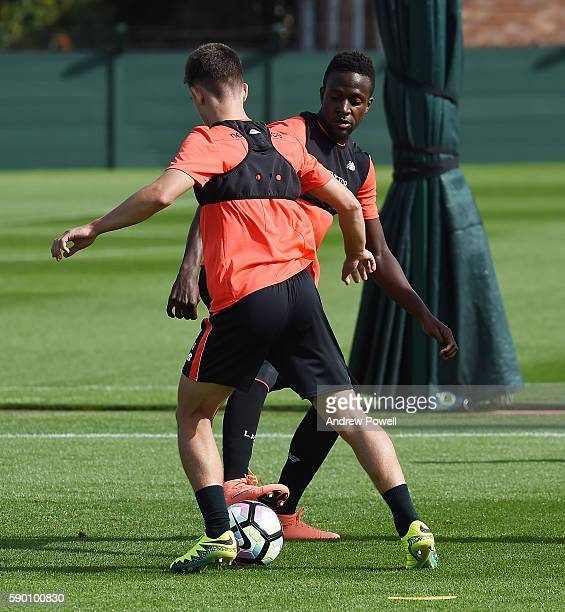 Divock Origi and Cameron Brannagan of Liverpool during a training session at Melwood Training Ground on August 16 2016 in Liverpool England