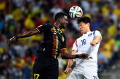 Divock Origi of Belgium and Ji DongWon of South Korea compete for the ball during the 2014 FIFA World Cup Brazil Group H match between Korea Republic...