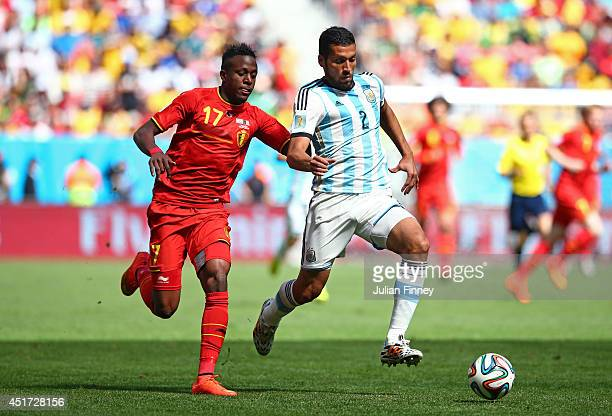 Divock Origi of Belgium challenges Ezequiel Garay of Argentina during the 2014 FIFA World Cup Brazil Quarter Final match between Argentina and...