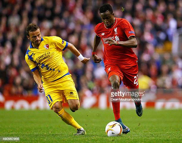 Divock Origi of Liverpool and Elsad Zverotic of Sion compete for the ball during the UEFA Europa League group B match between Liverpool FC and FC...