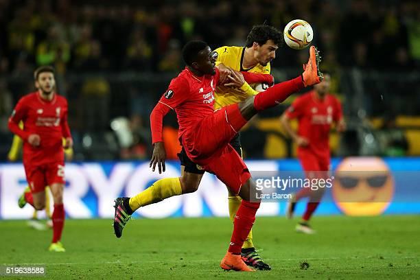 Divock Origi of Liverpool and Mats Hummels of Borussia Dortmund battle for the ball during the UEFA Europa League quarter final first leg match...