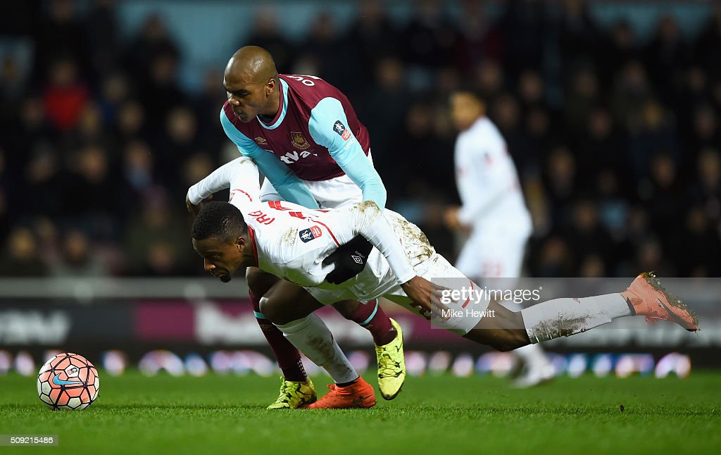 Divock Origi of Liverpool battles with Angelo Ogbonna Obinza of West Ham United during the Emirates FA Cup Fourth Round Replay match between West Ham United and Liverpool at Boleyn Ground on February 9, 2016 in London, England.