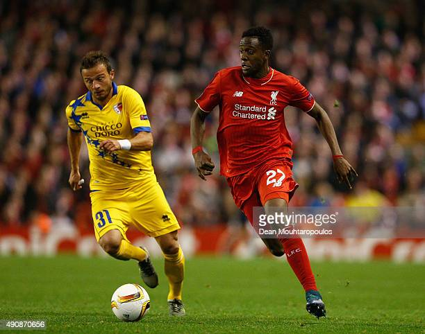 Divock Origi of Liverpool breaks away from Elsad Zverotic of FC Sion during the UEFA Europa League group B match between Liverpool FC and FC Sion at...