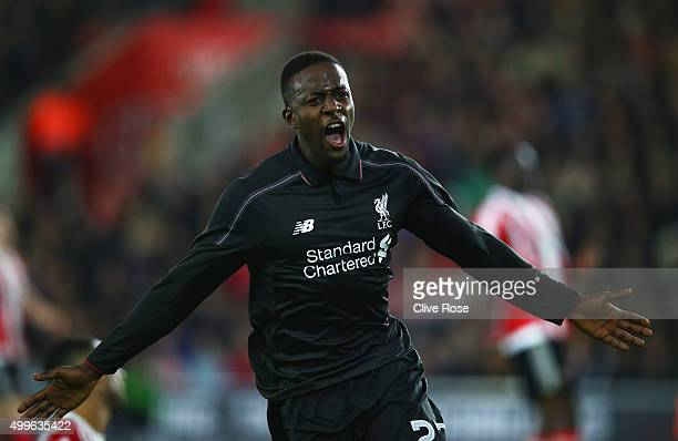 Divock Origi of Liverpool celebrates as he scores their fourth goal during the Capital One Cup quarter final match between Southampton and Liverpool...