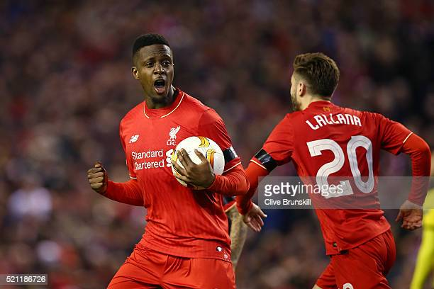 Divock Origi of Liverpool celebrates scoring his team's opening goal with Adam Lallana during the UEFA Europa League quarter final second leg match...