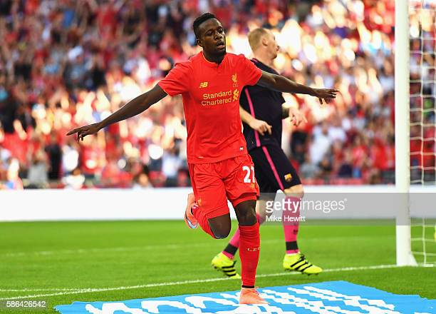 Divock Origi of Liverpool celebrates scoring his team's third goal during the International Champions Cup match between Liverpool and Barcelona at...