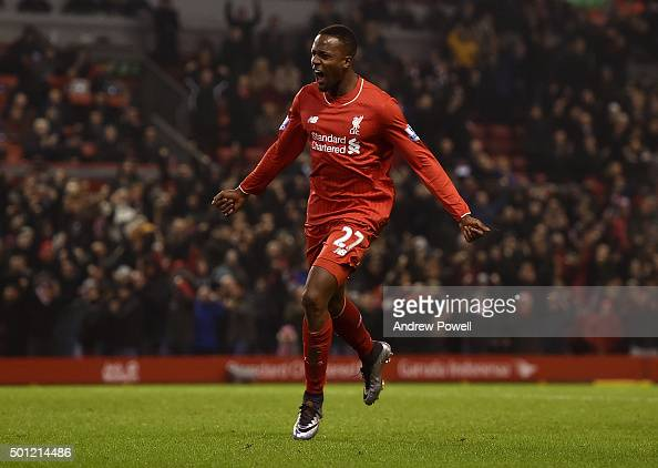 Divock Origi of Liverpool celebrates scoring the equalising goal during the Barclays Premier League match between Liverpool and West Bromwich Albion...