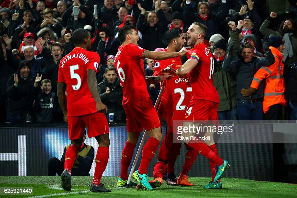 Divock Origi of Liverpool celebrates scoring the opening goal with his team mates during the Premier League match between Liverpool and Sunderland at...