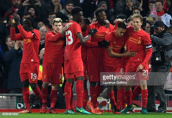 Divock Origi of Liverpool celebrates with team mates as he scores their first goal during the EFL Cup QuarterFinal match between Liverpool and Leeds...