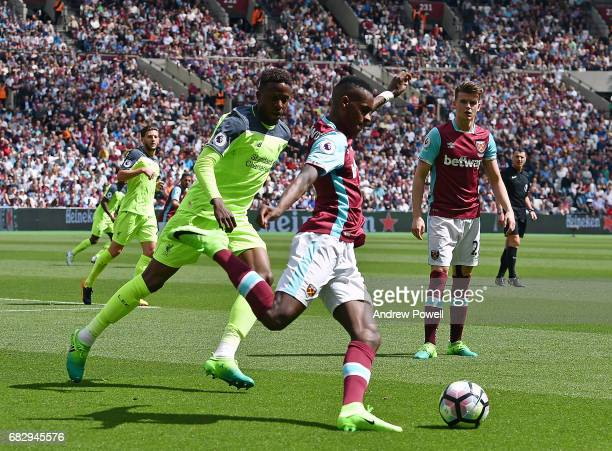 Divock Origi of Liverpool competes with Edimilson Fernandes of West Ham United during the Premier League match between West Ham United and Liverpool...