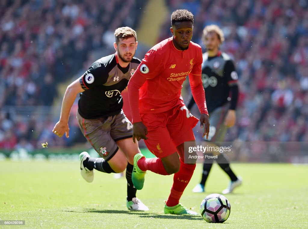 Divock Origi of Liverpool competes with Jack Stephens of Southampton during the Premier League match between Liverpool and Southampton at Anfield on May 7, 2017 in Liverpool, England.