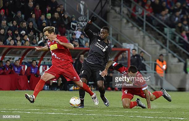 Divock Origi of Liverpool competes with Lo Lacroix of FC Sion during the UEFA Europa League match between FC Sion and Liverpool FC at Estadio...