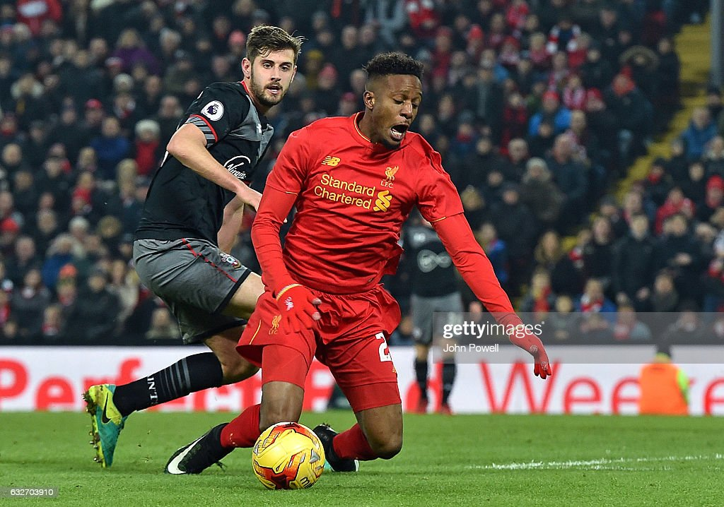 Divock Origi of Liverpool goes down in the Southampton box for a penalty claim not given in the last minute during the EFL Cup Semi-Final second leg match between Liverpool and Southampton at Anfield on January 25, 2017 in Liverpool, England.