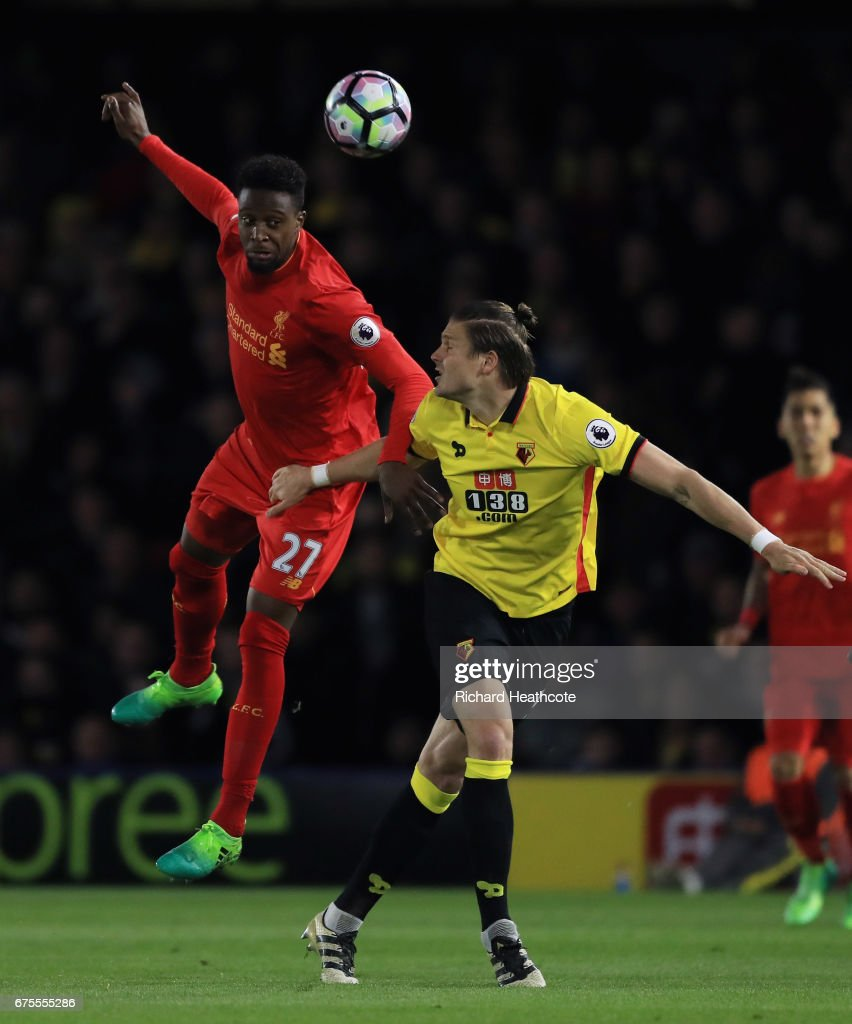 Divock Origi of Liverpool heads the ballunder pressure from Sebastian Prodl of Watford during the Premier League match between Watford and Liverpool at Vicarage Road on May 1, 2017 in Watford, England.